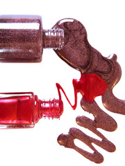 Nail polish is flowing from the bottle isolated on white