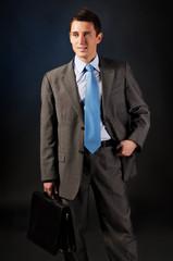 young businessman with a portfolio