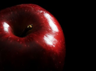 Close up image of red apple with black background