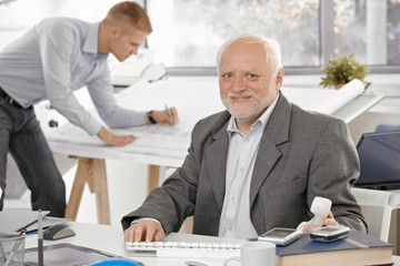 Senior businessman smiling in office