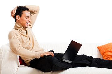 young man at home with laptop