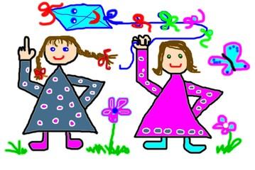 Mädchen mit Drachen auf der Spielwiese
