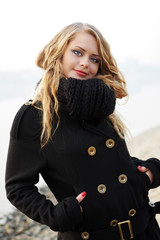 young blound woman in black scarf and overcoat