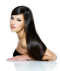 Beautiful young woman with long straight brown hair