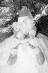 Santa Claus sits, in wood
