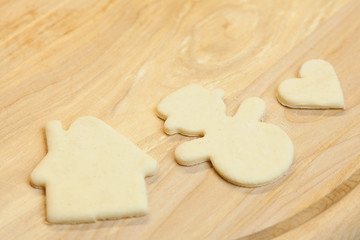 cut in the dough snowman, heart, and  house