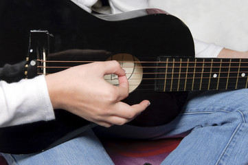 Playing a Black Guitar