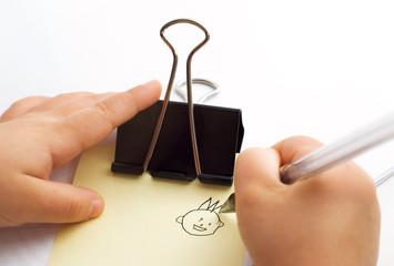 child draws a person
