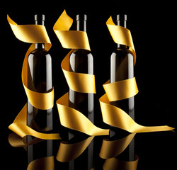 Wine bottles with gold ribbon