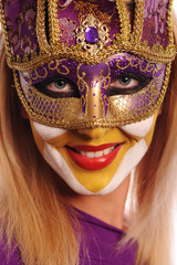 smiling woman in half mask