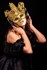 woman in golden half mask