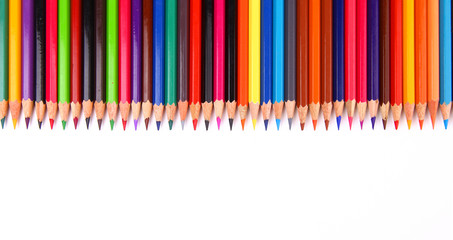 Assortment of coloured pencils with shadow