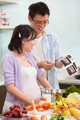 Asian couple looking at USG fetus picture