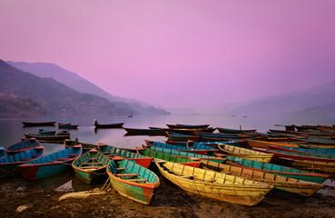 Wall Murals Nepal Beautiful twilight landscape with boats on Phewa lake, Pokhara,
