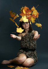 The girl with falling maple leaves