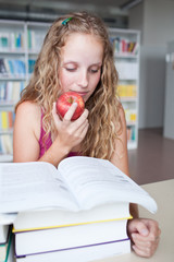 pretty female college student in a library (shallow DOF; color t