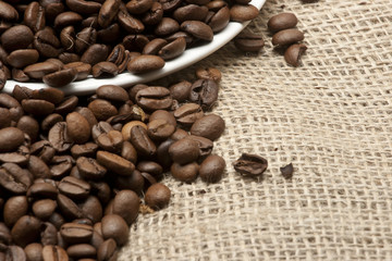white saucer on coffee beans and sacking