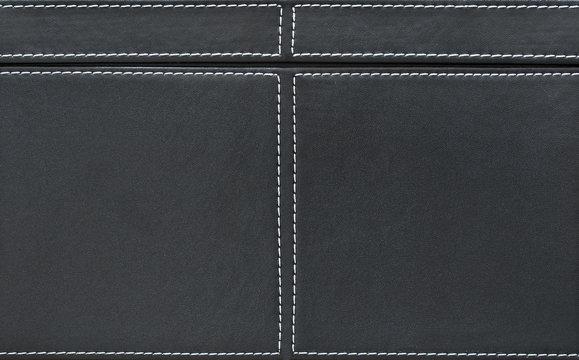 Fond cuir noir et coutures