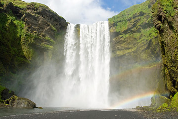 Skogarfoss on the Iceland with a rainbow