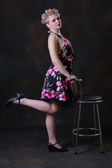 Fifties style female with stool