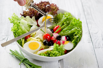 olive oil over mixed salad