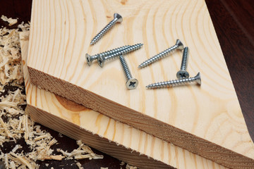 Several screws on wooden planks
