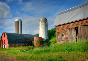 Run Down Barn with Silos in the Background