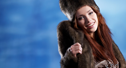 Beautiful woman in winter fur coat