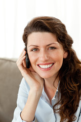 Portrait of a pretty businesswoman talking on the phone at home