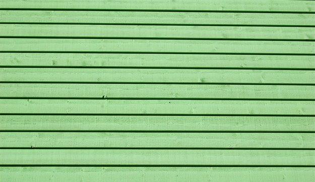 Mur en bois coloré en vert