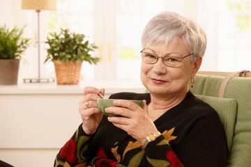 Portrait of senior lady drinking tea