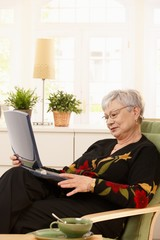 Modern pensioner with laptop