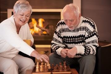 Senior couple having fun with chess