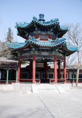 Traditional chinese pavilion with green ornate roof