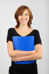 Portrait of cute girl with textbook