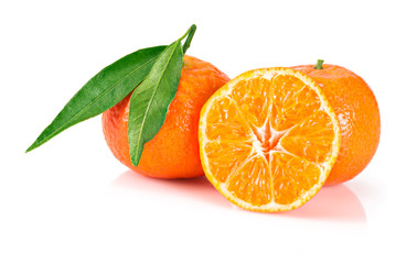 Ripe tangerines with leaves on white background