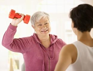 Senior woman doing dumbbell exercise