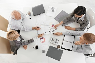 Businesspeople working together at meeting