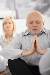 Portrait of meditating businessman