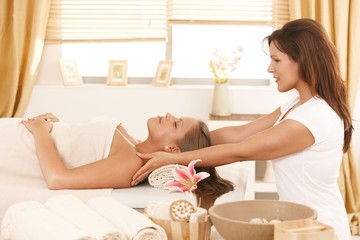 Young woman getting massage in day spa