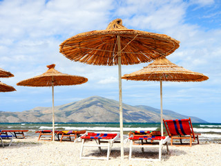 straw parasols on the beach