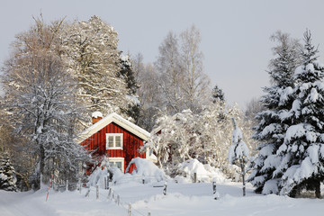 red cottage, snow and ice in sweden