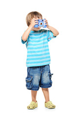 Full length portrait of a little boy taking pictures with a came