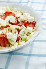 Salad with feta cheese, tomato and corn