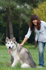 Chinese girls, taking pictures with a dog