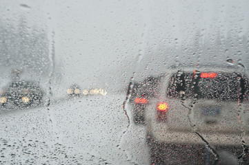 Winter traffic jam seen through a windshield