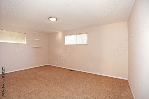Empty Bedroom With Small Windows Stock Photo And Royalty Free