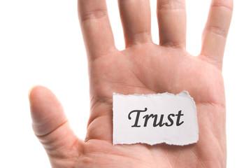 Trust word in hand