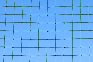 Net with blue sky on background