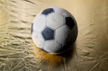 soccer ball on golden background
